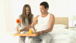 Woman drinking orange juice while she having break Stock Video Footage