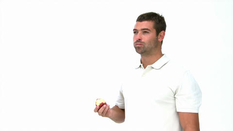 Happy man eating an apple Footage