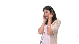 Smiling woman listening to music Footage