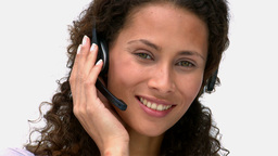 Closeup of a smiling businesswoman talking with he Stock Video Footage