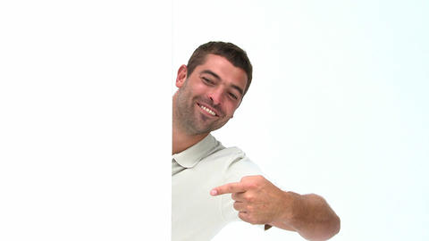 Happy man showing a white board Footage