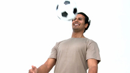 Happy man playing with a soccer ball Stock Video Footage