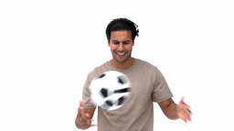 Smiling man playing with a soccer ball Footage
