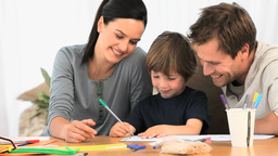 Parents looking at their lovely son drawing Footage