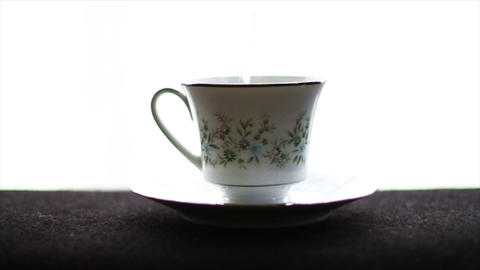 1592 Tea Cup with Water being Poured into it Footage