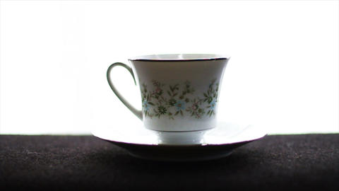 1592 Tea Cup with Water being Poured into it Stock Video Footage