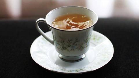 1598 Tea Drops in Tea Cup, Slow Motion Footage