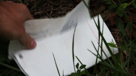 1608 Letter being Picked up from the Grass Stock Video Footage