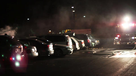 1616 Big Car Fire in Parking Lot with Fire Trucks Footage