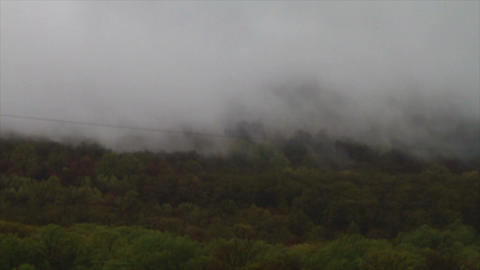 1461 Fog and Clouds Coming down Mountain Stock Video Footage