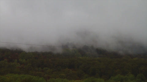 1461 Fog and Clouds Coming down Mountain Footage