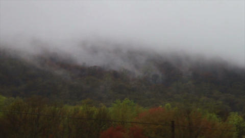 1463 Fog and Clouds Coming down Mountain Stock Video Footage