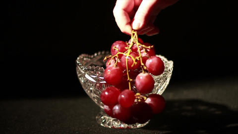 1501 Grapes being Picked Up in Glass Bowl, Slow Mo Footage