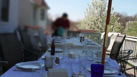 1335 Table Set On A Spring Day On Wooden Deck stock footage