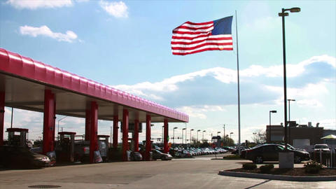 American Flag next to Gas Station, Slow Motion Stock Video Footage