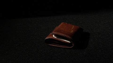 1378 Leather Wallet Being Thrown Down, Slow Motion Footage