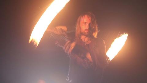 bearded man in fire performance Footage