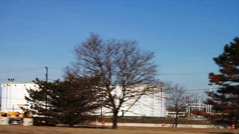 1091 Driving by Factory with Smoke Stakes Releasin Stock Video Footage