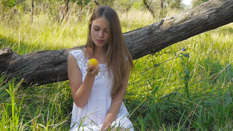 Girl Eats A Peach stock footage