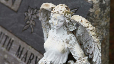 1110 Stone Angel Next to Grave Stone Stock Video Footage