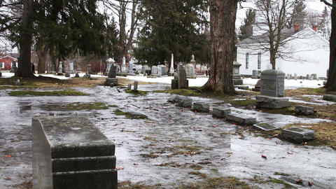 1113 Grave Yard Under Ice next to Old Church Footage