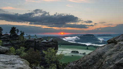 sunset and fog saxon swiss mountain time lapse 114 Stock Video Footage