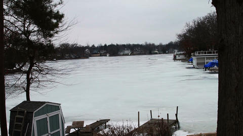 1121 Frozen Lake During Winter Next to Houses Footage