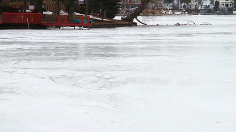 1128 Frozen Lake During Winter Next to Houses Stock Video Footage