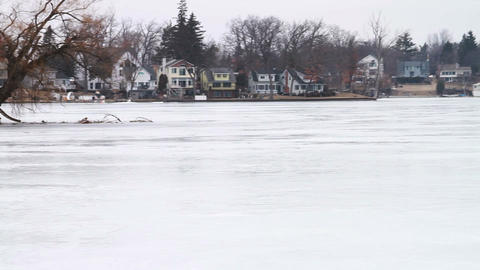 1128 Frozen Lake During Winter Next to Houses Footage