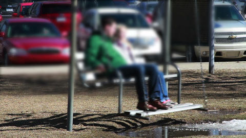 1135 Couple on Swing Bench at Park, Blur Stock Video Footage