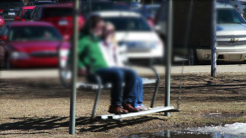 1135 Couple On Swing Bench At Park, Blur stock footage