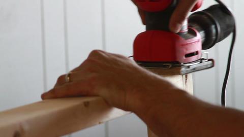 1145 Man Sanding Wood Frame stock footage