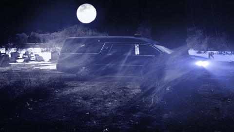 Hearse Funeral Vehicle at Night in Grave Yard with Footage