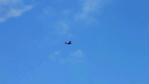 1183 Airplane Flying with Clouds and Blue Sky Footage