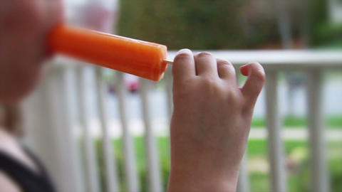 1211 Child Eating a Popsicle , Orange Stock Video Footage