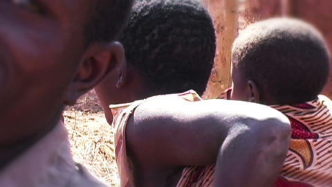 0873 Women in Africa with Child on her Back Footage