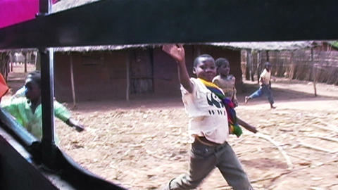 0882 Childern in Africa Running after Car and say  Footage