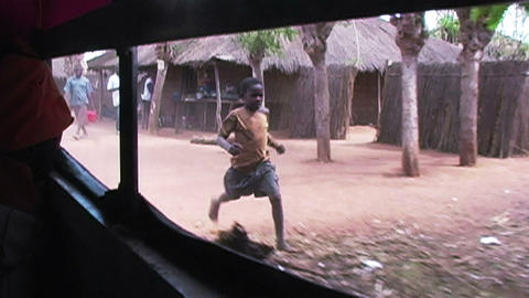 0883 Children in Africa Running after Car and say Footage