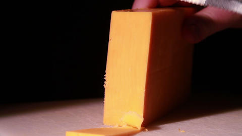 Cheddar Cheese Being Cut stock footage