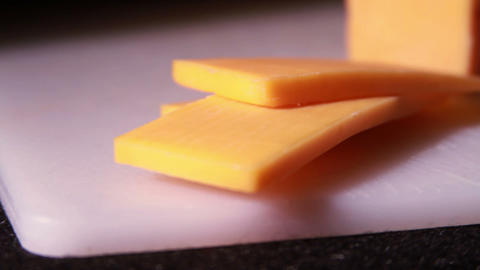 Cheddar Cheese being Cut Stock Video Footage