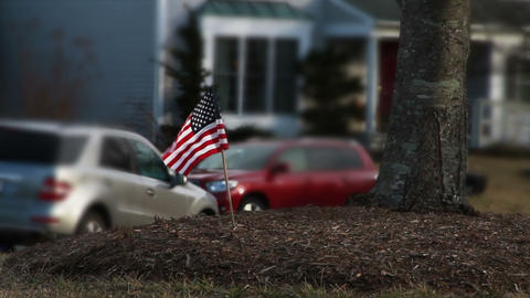 American Flag in Front Yard of House Stock Video Footage