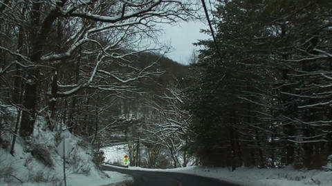 0720 Driving in Snow through the Trees, Slow Motio Stock Video Footage