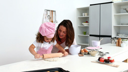 Beautiful woman baking with her daughter Footage