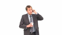 Businessman drinking while phoning Footage