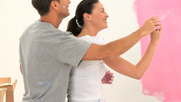 Couple paintaing a wall together Footage