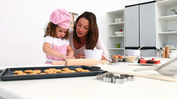 Adorable girl baking with her mother Stock Video Footage