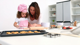 Adorable girl baking with her mother Footage