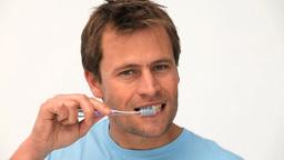 A man brushing his teeth Footage