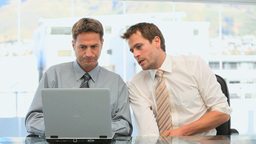 Businessmen working together in a office Stock Video Footage