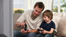 Boy playing with his father Stock Video Footage